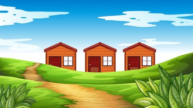 Drie huizen op het veld
