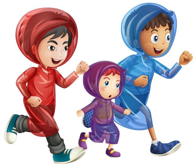 Drie jongens in regenjassen
