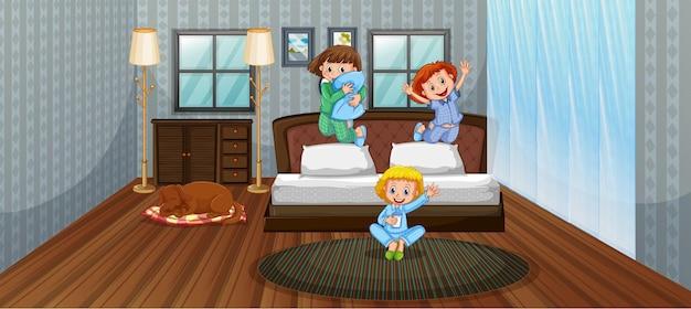 Drie kinderen hebben plezier in de slaapkamer