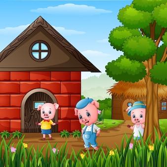 Drie kleine varkens in het dorp
