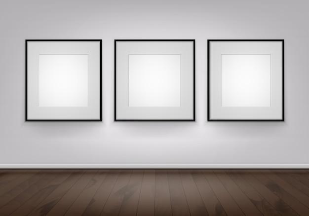 Drie lege posters afbeeldingen zwarte frames op de muur