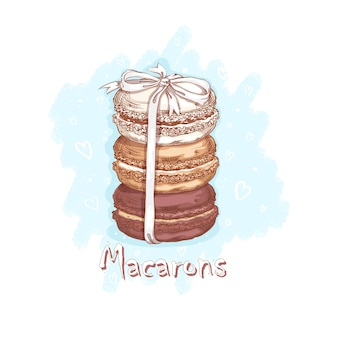 Drie macarons gebonden met een wit lint. snoepjes en desserts. schetsmatige handtekening