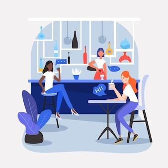 Drie meiden, zittend in een leuk café, restaurant of bar, aan het drinken.