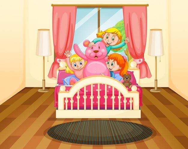 Drie meisjes in slaapkamer met roze teddybeer