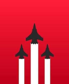 Drie militaire straaljagers met witte sporen