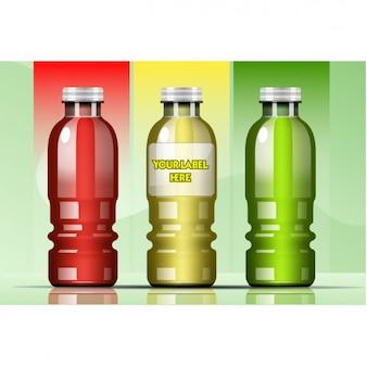 Drie plastic flessen Gratis Vector