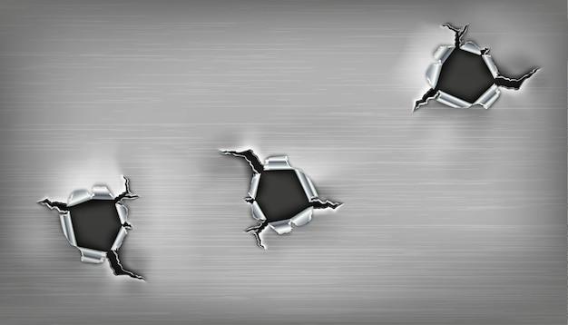 Drie rafelige gaten in het metaal