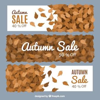 Drie verkoop banners met droge bladeren