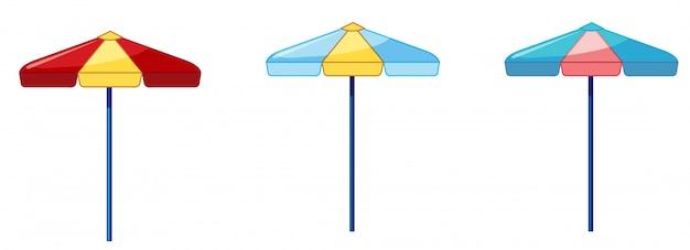 Drie verschillende kleurenparaplu op whit achtergrond