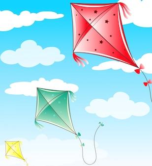 Drie vliegers die in blauwe hemel vliegen