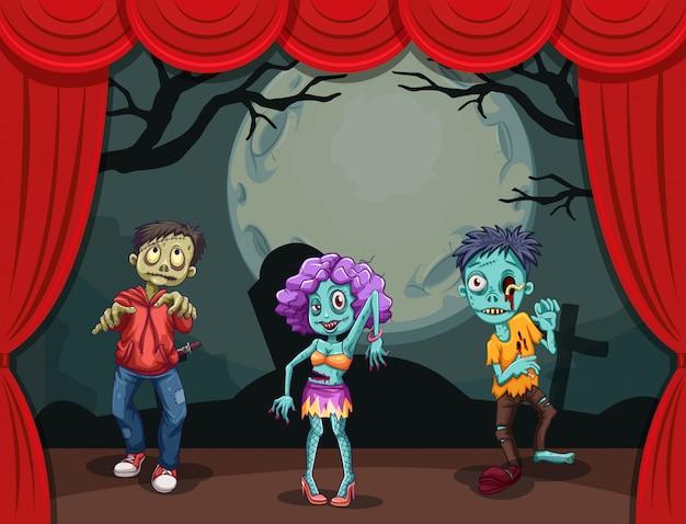 Drie zombies op het podium