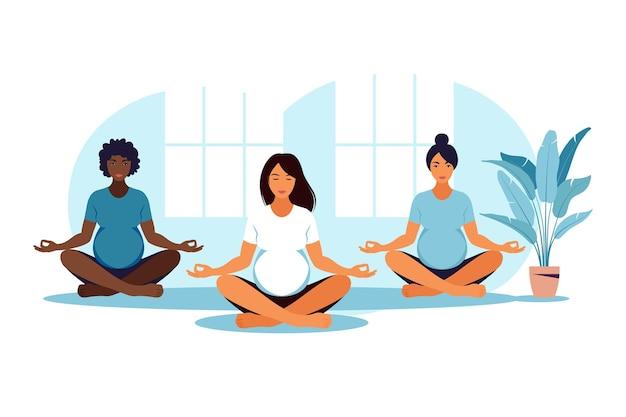 Drie zwangere vrouwen beoefenen yoga en meditatie in de klas