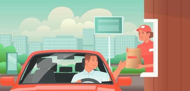 Drive thru man rijdt naar een fastfoodcafé en haalt zijn bestelling op v