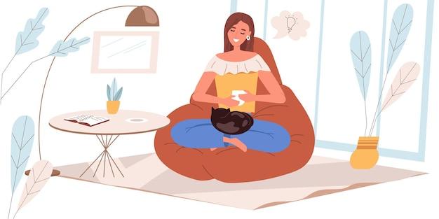 Dromend mensenconcept in vlak ontwerp. gelukkige vrouw zit, droomt, drinkt thuis koffie. jong meisje zit in een gezellige kamer, stelt zich voor en komt met ideeën, mensenscène. vector illustratie