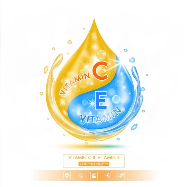 Druppel blauw vitamine e-oplossingserum en oranje vitamine c op witte achtergrond