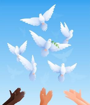 Duiven vlakke compositie met heldere blauwe lucht en mensenhanden van verschillende kleur duiven bevrijden