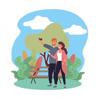Duizendjarig paar die selfie parkbank n aard splarsh frame glimlachen