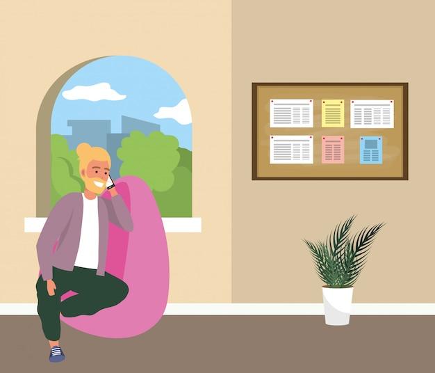 Duizendjarige student zittend op wachtkamer