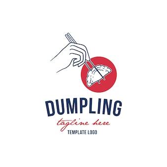 Dumpling food design logo genomen met stokjes.