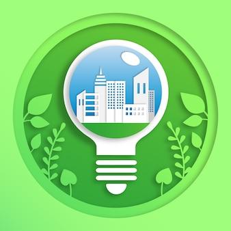 Ecologie concept met gloeilamp in papierstijl