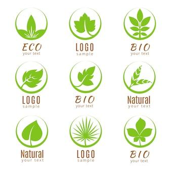 Ecologie etiketten met groene bladeren op wit