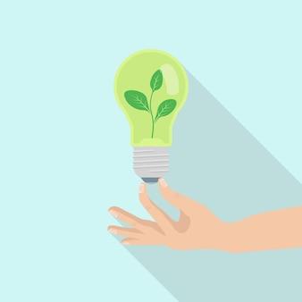 Ecologie gloeilamp in menselijke hand. groene energie