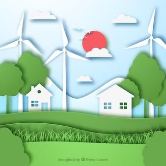 Ecosysteemconcept met huizen en windmolens