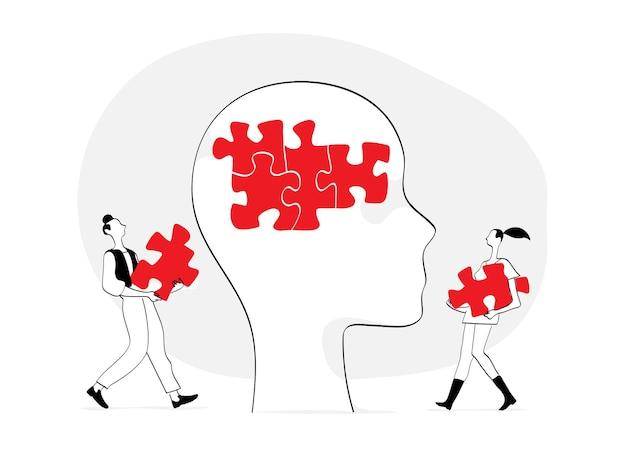 Een aantal jonge mensen die de puzzel in het menselijk hoofd voltooien