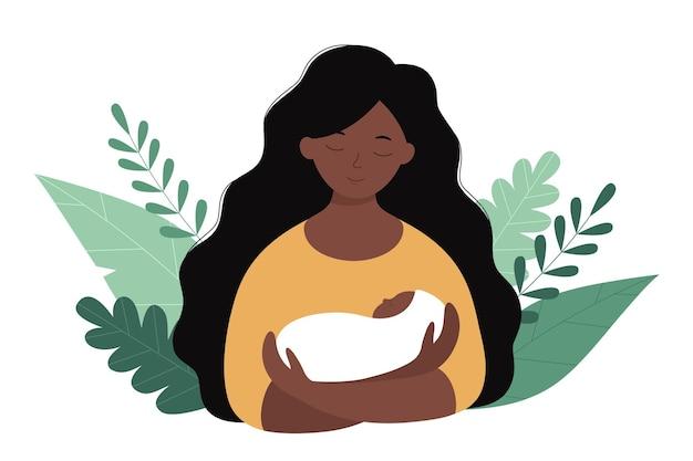 Een afro-amerikaanse moeder en een pasgeboren baby in haar armen
