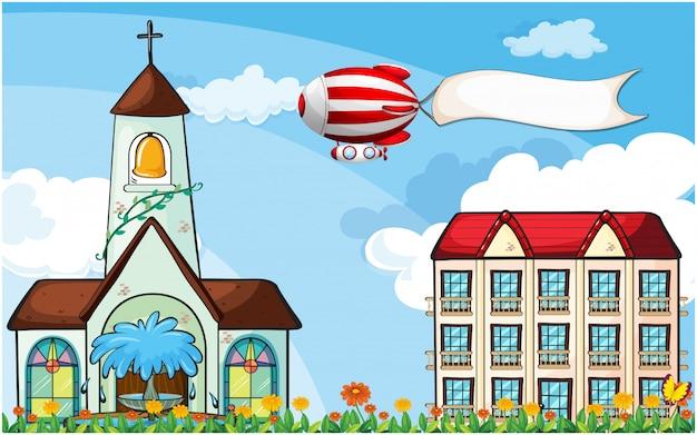 Een ballon met een lege banner die dichtbij de kerk vliegt