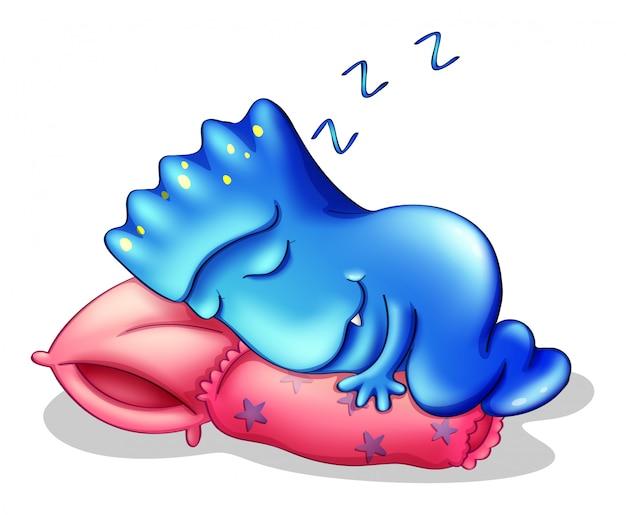 Een blauw monster dat boven een kussen slaapt