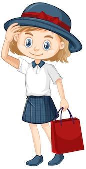 Een blij meisje met rode papieren zak