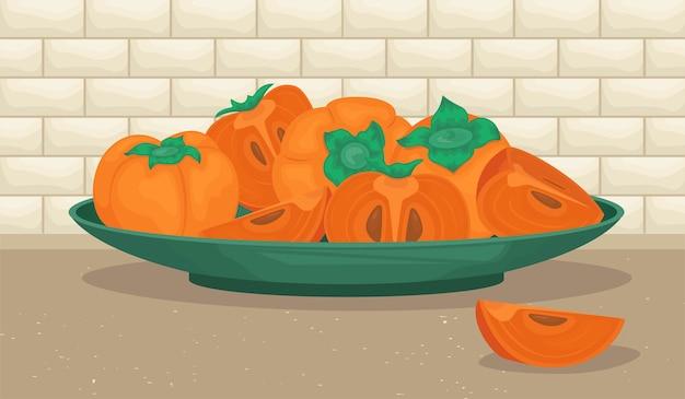 Een bord met rijpe dadelpruimen. persimmon heel en stukjes.