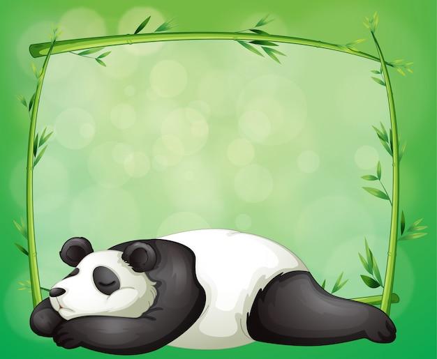 Een briefpapier met een bamboeframe en een panda Premium Vector