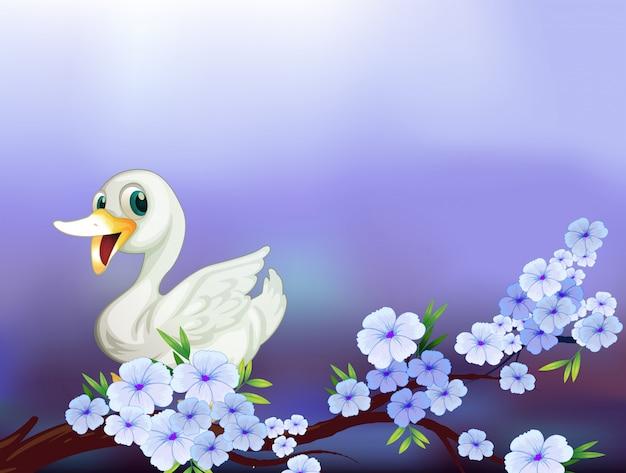 Een briefpapier met een witte eend en bloemen