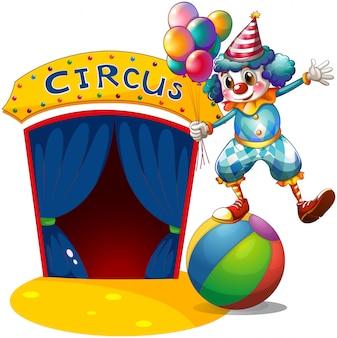 Een clown met ballonnen balancerend boven een bal