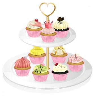 Een cupcakebak met roze cupcakes