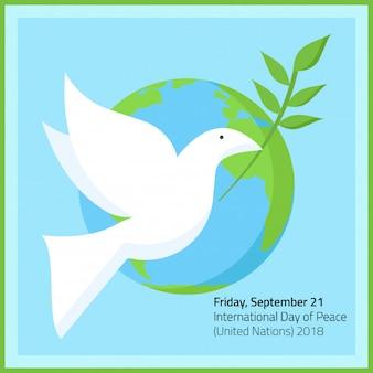 Een duif met groene bladeren in vredesdag 21 september
