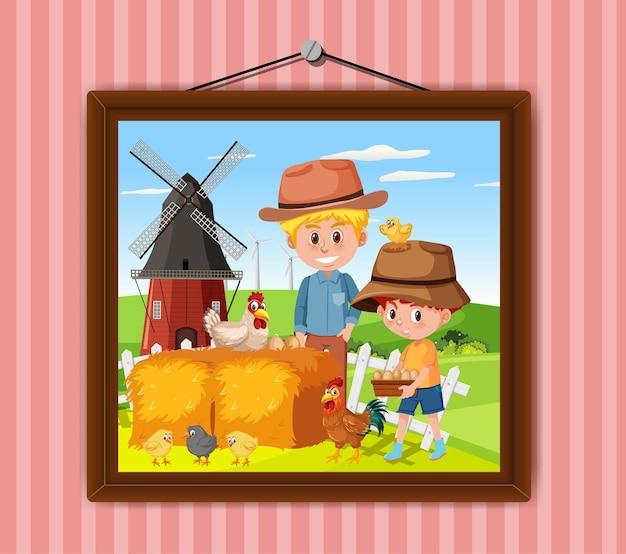 Een foto van vader en zoon in de boerderijtafereel aan de muur
