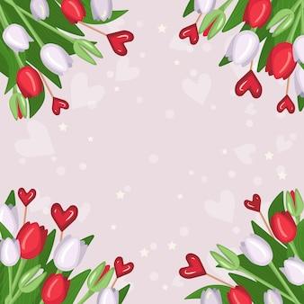 Een frame van boeketten van bloemen van heldere lente witte en rode tulpen, harten hape lolly's, groene stengels en bladeren.