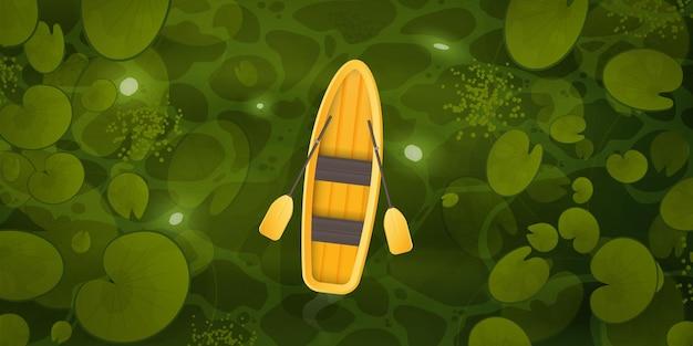 Een gele boot drijft door een moeras met waterleliebladeren