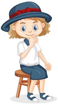 Een gelukkig meisje zittend op een stoel