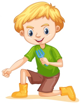 Een gelukkige jongen met tuinieren vork
