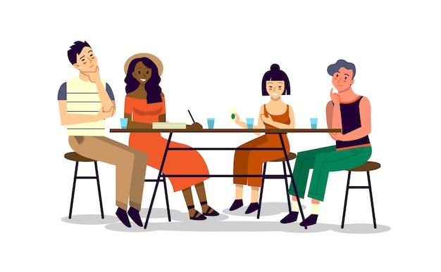 Een gelukkige vriend brengt tijd samen door en praat. man en vrouw zitten samen aan tafel, eten en praten.