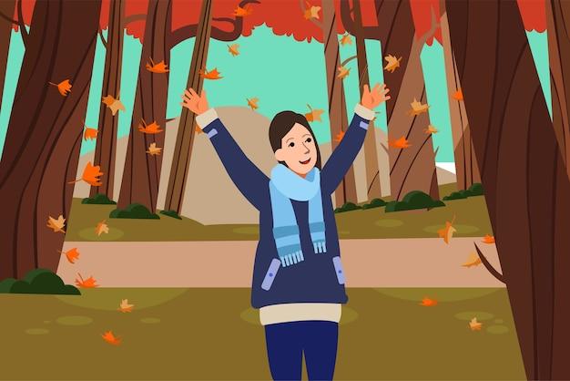 Een gelukkige vrouw houdt van een natuurlijk de herfstseizoen in het park