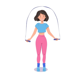 Een gespierd meisje doet oefeningen met een springtouw in sportkleding