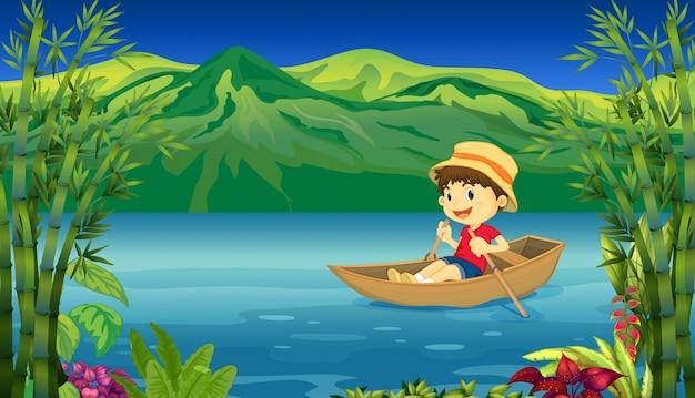 Een glimlachende jongen in een boot