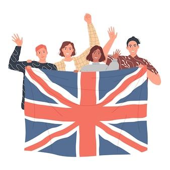 Een groep mensen houdt de britse vlag vast en leert engels