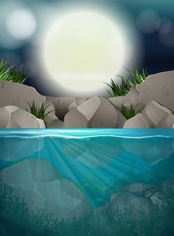 Een grote volle maannacht bij de rivier