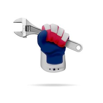 Een hand in een patriottische werkhandschoen houdt een verstelbare sleutel vast.